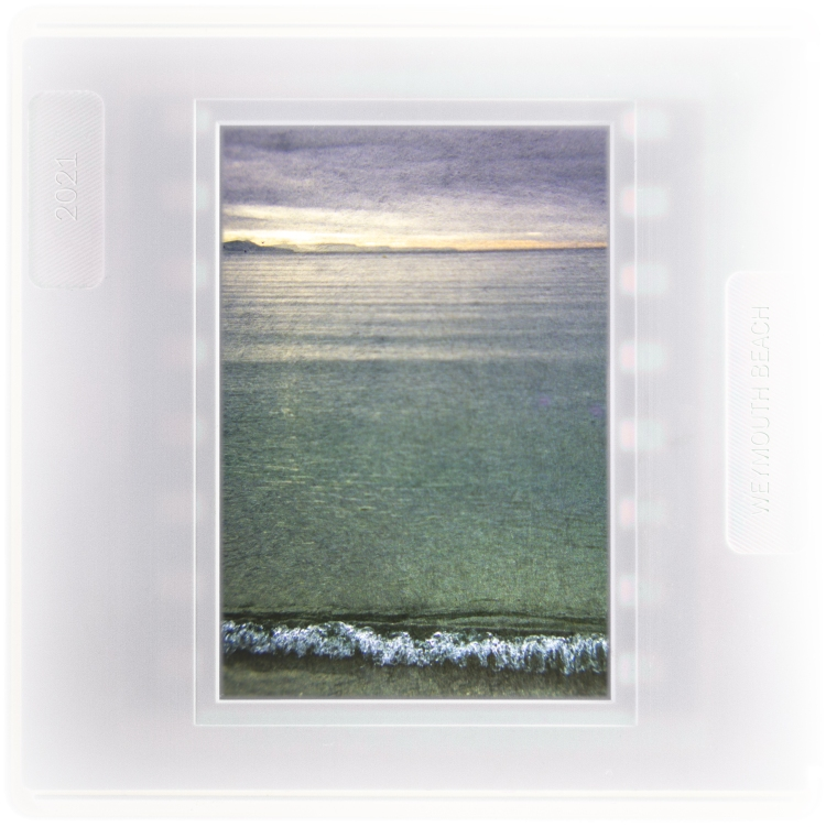 Waves rippling onto Weymouth Beach towards dusk
